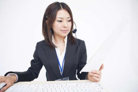 new recruit: Woman wearing headset Stock Photo