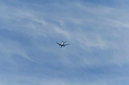cirrus: Airliner flying under the Cirrus