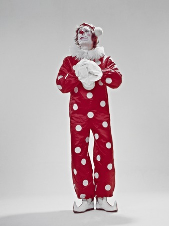 horizont: Red clown to be acting in a white Horizont Stock Photo
