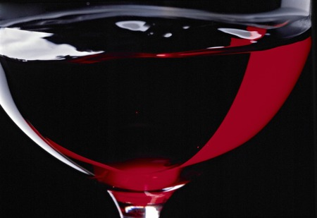sizzle: Sizzle up of glass that has been poured the red wine Stock Photo