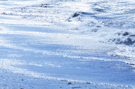 washed: Winter beach to be washed to violently wave
