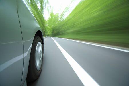 hybrid car: Hybrid car tire that runs through the fresh green Stock Photo