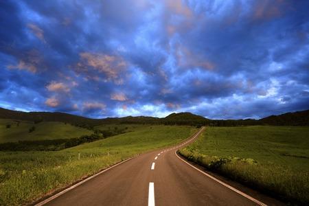 straight path: Sunrise road Stock Photo