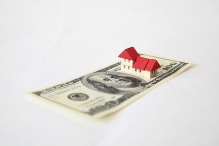 subprime: 100 bills and toys home.