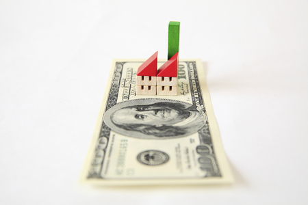 subprime: 100 bills and toy factory.
