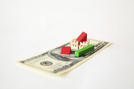 subprime: 100 dollar banknotes and broken toys factory Stock Photo