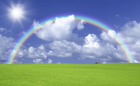 Prairie redroofed house with clouds and Sun and Rainbow