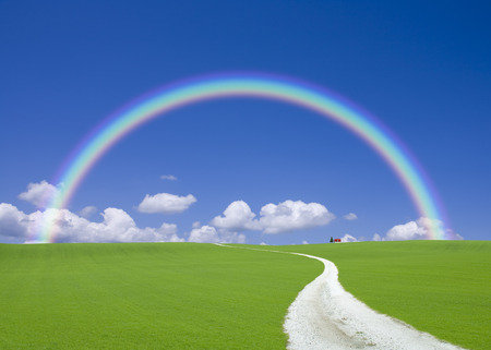 housing lot: White road leading to the House with the red roof and the Rainbow Stock Photo