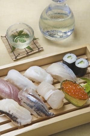 Nigiri sushi and cold sake Stock Photo