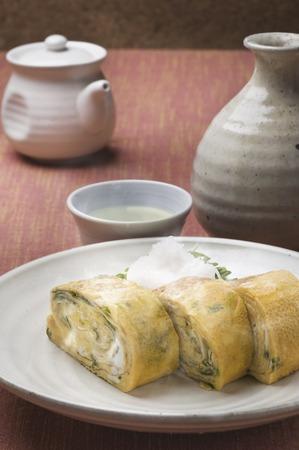 alchoholic: Sake and fried eggs Stock Photo