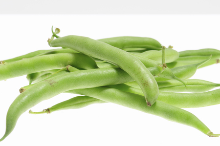 The green beans on white back Фото со стока