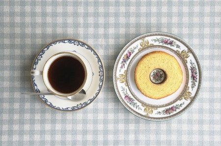 birdseye view: Birds-eye view of Baumkuchen and coffee on the table