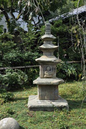 quadruple: Quadruple tower made of stone of the Japanese garden