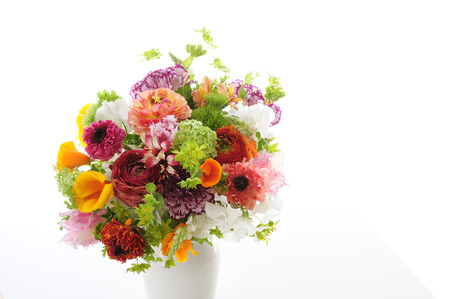 Spring flower of flower arrangements in white back was placed in a vase Archivio Fotografico