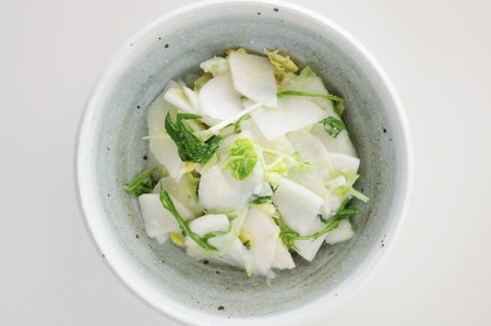birdseye view: Birds-eye view of the white vegetable salad that was placed in a bowl