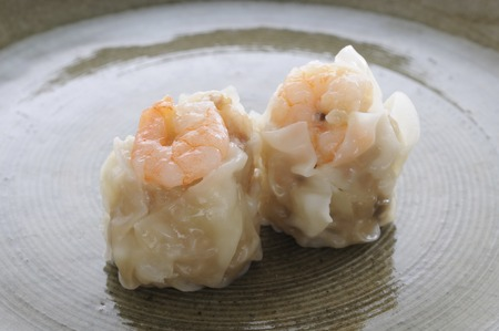 two pieces: Two pieces of shrimp dumplings on the dish