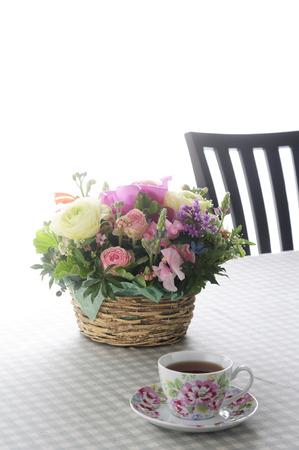 flower arrangements: Flower arrangements and tea on the table