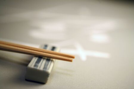 rest: Chopsticks and chopstick rest Stock Photo