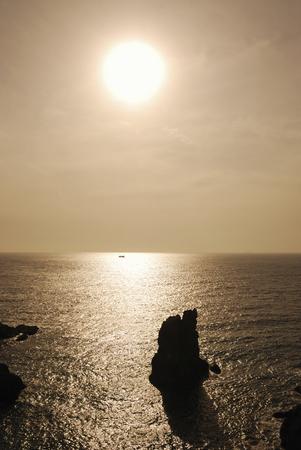 setting  sun: Setting sun and the sea Stock Photo