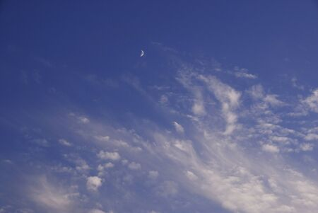 crescent: Blue sky and a crescent moon