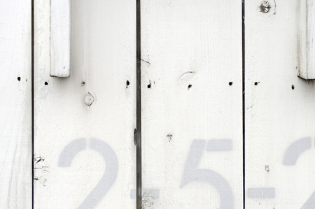 white wall: The numbers drawn on the white wall Stock Photo