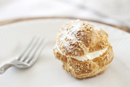 puff: Cream puff and fork Stock Photo