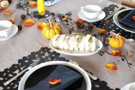 candle light table setting: Halloween table Stock Photo
