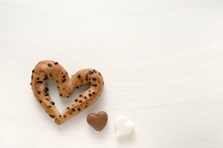 choco chips: Heart-shaped bread and macaroons Stock Photo