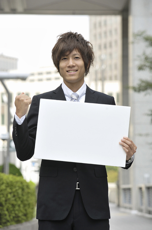 fist pump: Businessman with message board