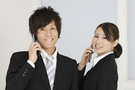 consign: Young businessmen and OL Stock Photo