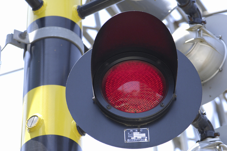 railroad crossing: Red flashing of the railroad crossing