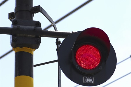 railroad crossing: Display and a red flashing railroad crossing Stock Photo