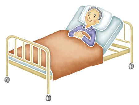 ベッドで寝ている老人 写真素材