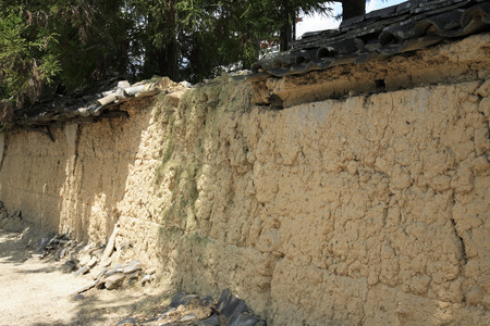 collapsed: The collapsed earthen wall