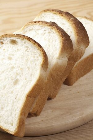 delectable: Loaf of bread cut with knife. Stock Photo