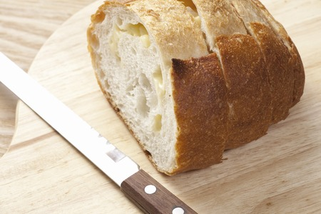 delectable: French bread cut with knife.