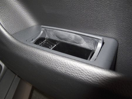 passenger car: Ashtray in the rear seat of the passenger car