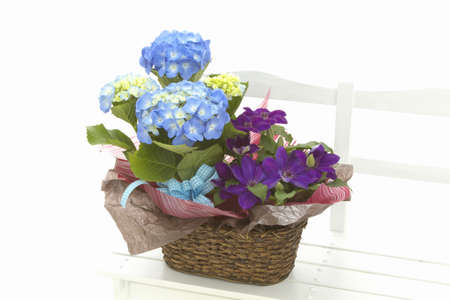 flower basket: White chairs and flower basket