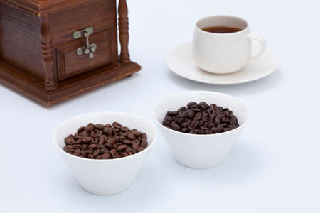 tableware life: Coffee beans and hot coffee Stock Photo