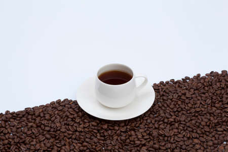 plural number: Coffee beans and hot coffee Stock Photo