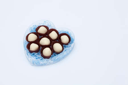 entered: White chocolate that has entered the heart of the container Stock Photo