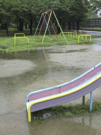 trapeze: Plaything of the park wet in the rain Stock Photo