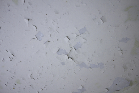 dampness: Peeling paint on the ceiling of the old building Stock Photo