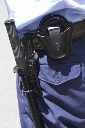 nightstick: Handcuffs and batons to have the police officers Stock Photo