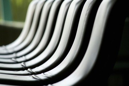 neatness: Chair of lined counter Stock Photo