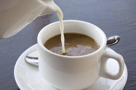 au: Cafe au lait pour milk Stock Photo