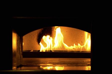 Kiln burning pizza Stock Photo