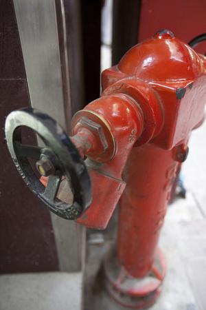 street corner: Red fire hydrant in a street corner Stock Photo
