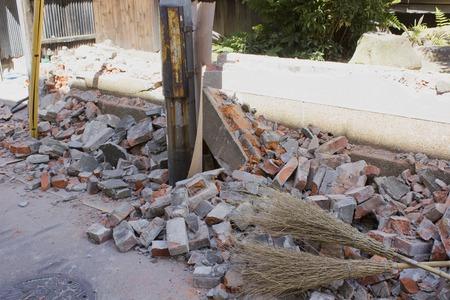 power shovel: Demolition of houses of brick wall Stock Photo