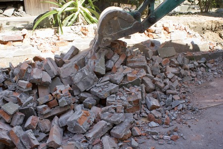 disassemble: Demolition of houses of brick wall Stock Photo
